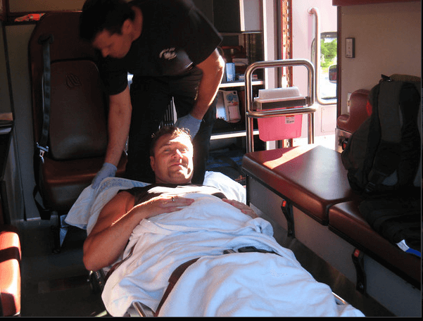 Laying on a stretcher after quad tendon rupture accident